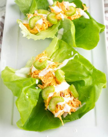 2 buffalo chicken lettuce wraps on a platter