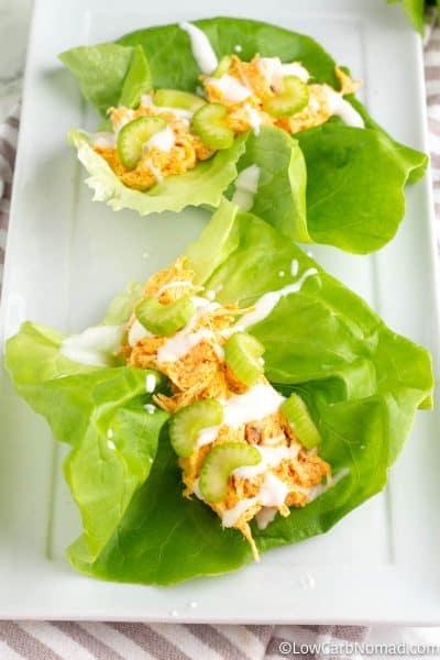 2 buffalo chicken lettuce wraps on a platter
