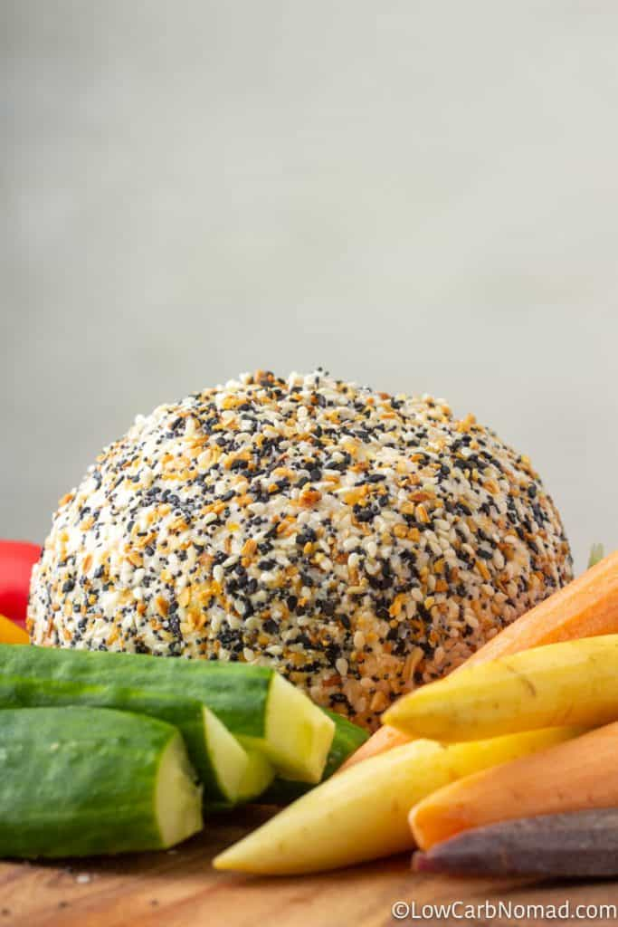 Everything bagel Cheeseball recipe on a platter with carrots, cucumbers, peppers and sugar snap peas