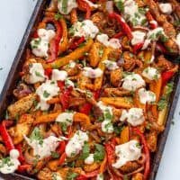 cooked keto fajita on a sheet pan with white queso
