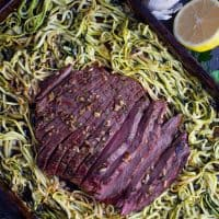 cooked sheet pan oven baked steak recipe with zucchini noodles sliced