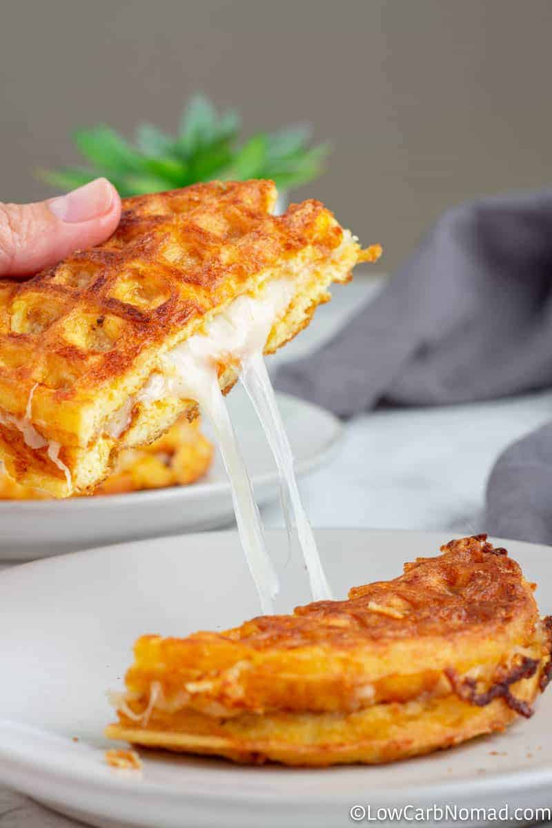 Grilled Cheese Chaffle on a plate with a side salad
