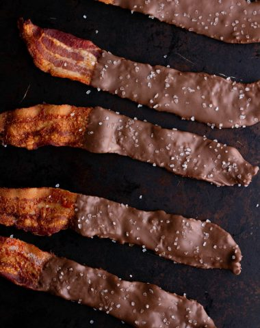 Low carb chocolate covered bacon on a tray