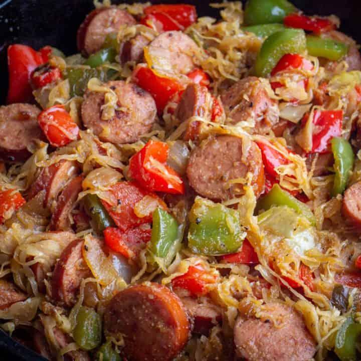 kielbasa and sauerkraut skillet recipe in a cast iron skillet