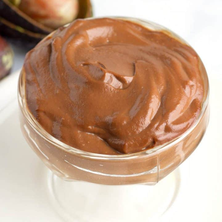 large glass dish full of chocolate avocado pudding that is low carb and keto.