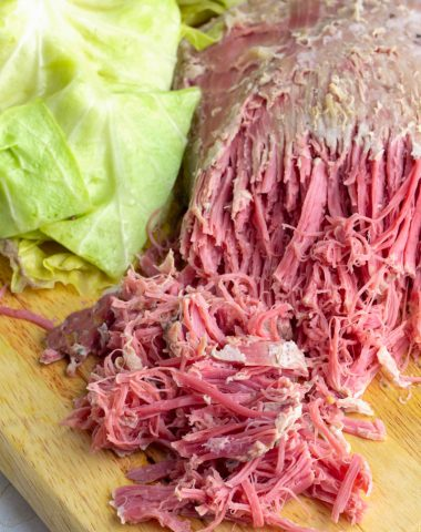 Easy Crockpot corned beef and cabbage on a platter done cooking