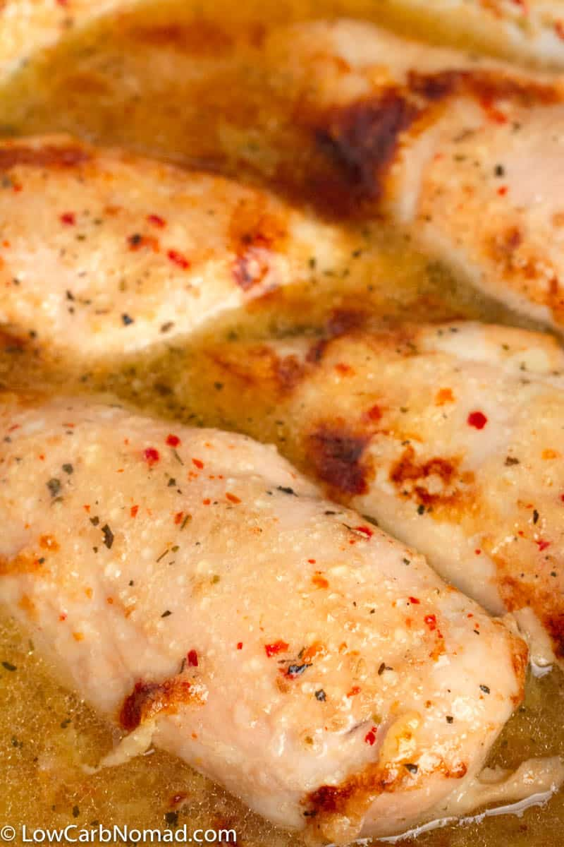 italian chicken cooking in a baking dish