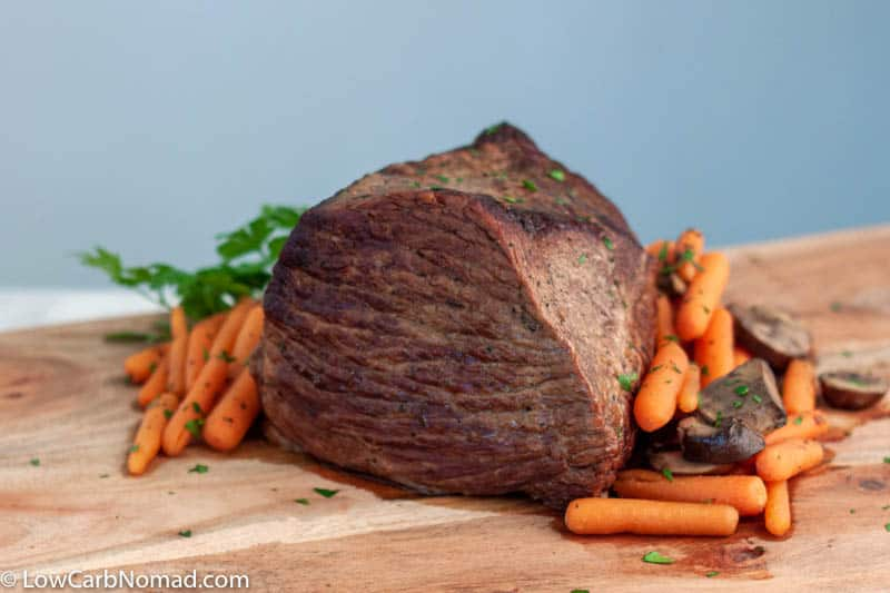 roast beef on table with vegetables