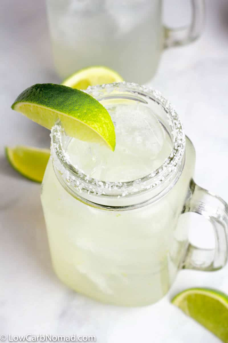 Low Carb Skinny Margarita Recipe in a mason jar glass garnished with a lime and sea salt