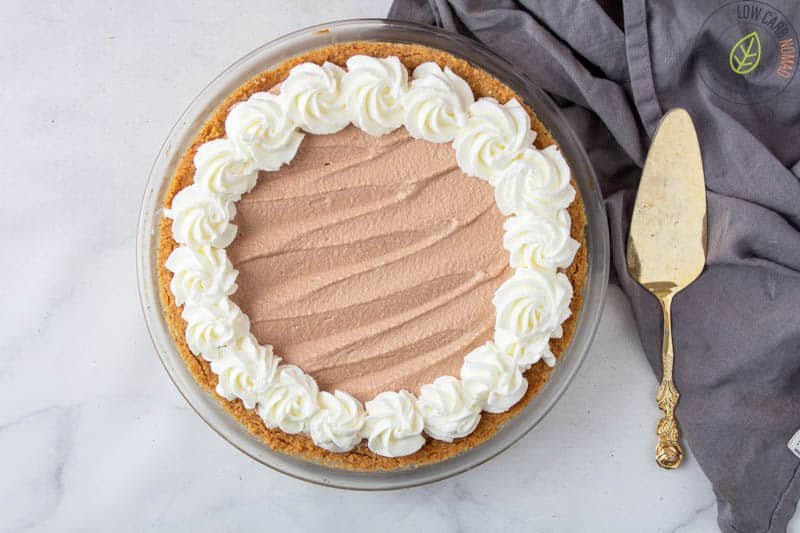 Chocolate Mousse pie finished - pie crust filled with chocolate mousse and topped with whipped cream.