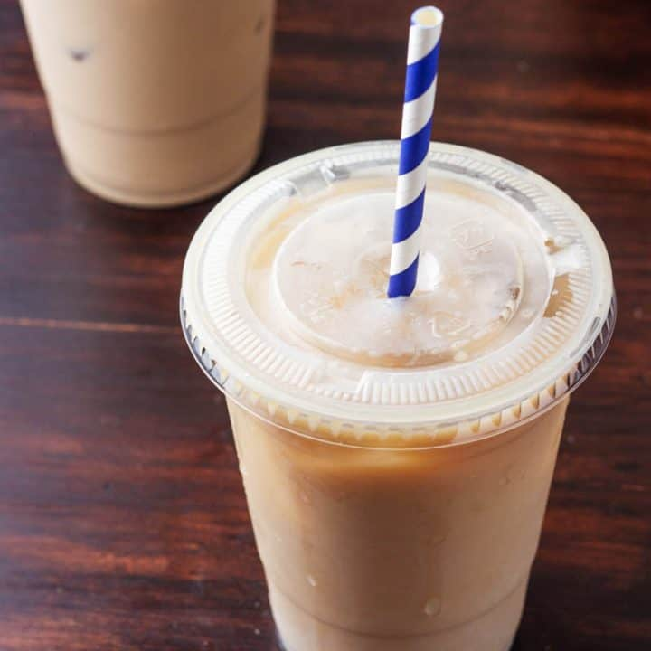 low carb iced coffee in a plastic cup with a straw
