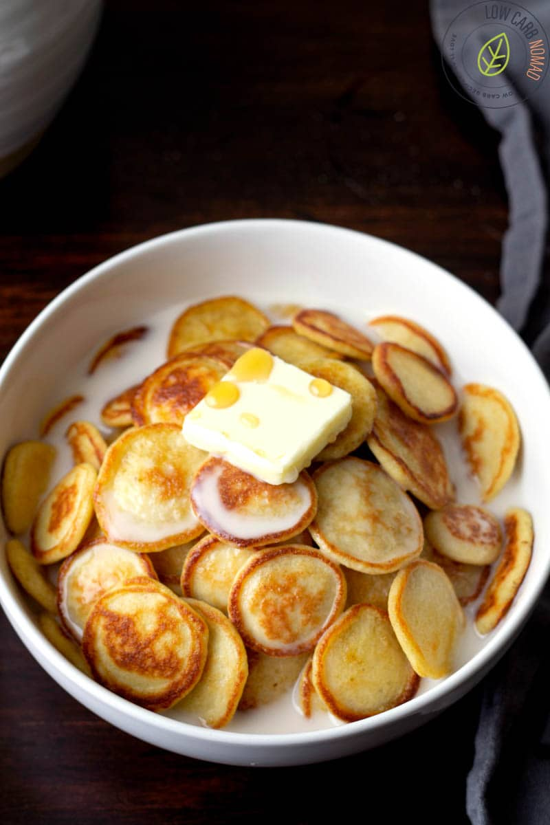 low carb pancakes in a bowl to make pancake cereal with milk, butter and sugar free maple syrup