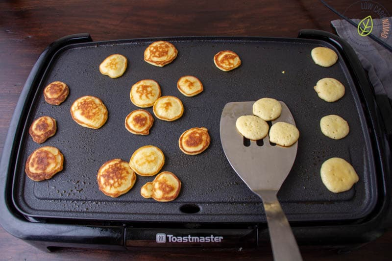 flipping pancakes on cooktop