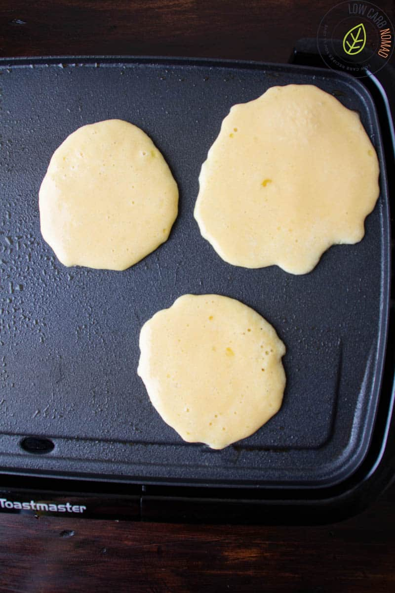 keto pancakes on a griddle cooking