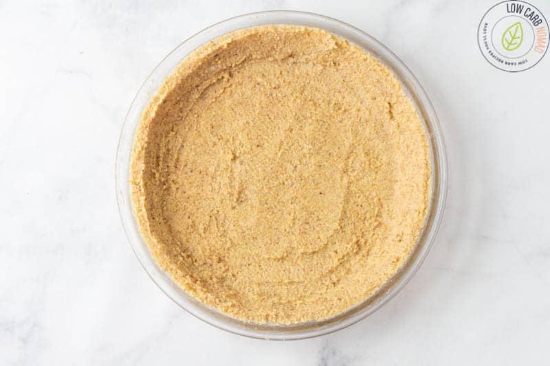 unbaked keto walnut pie crust in a pie pan