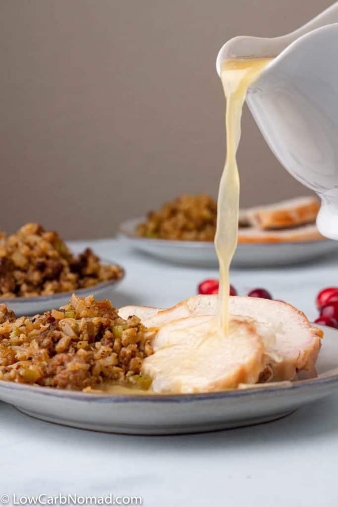 Keto Turkey Gravy being poured on turkey