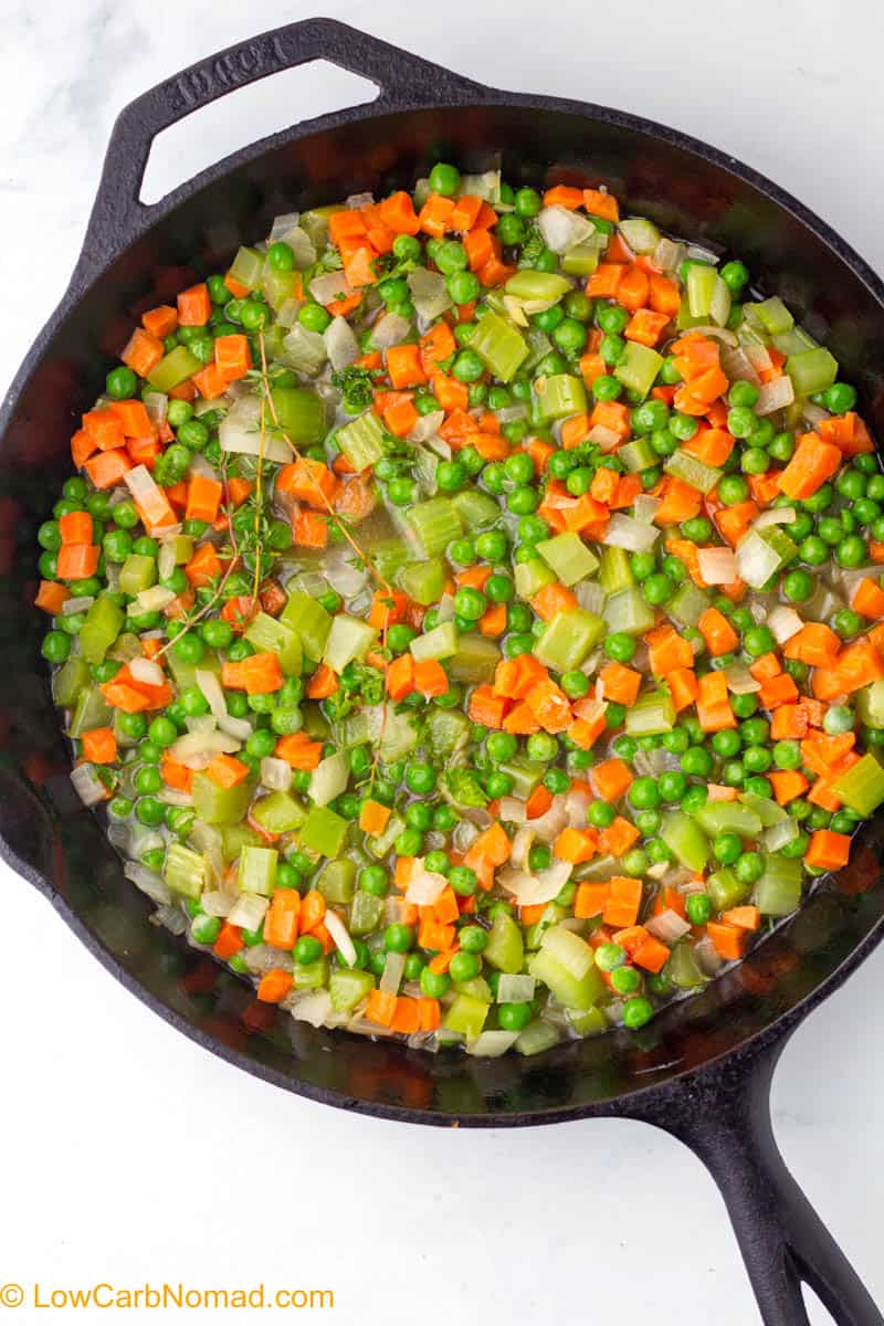 Veggies cooking in a cast iron skillet