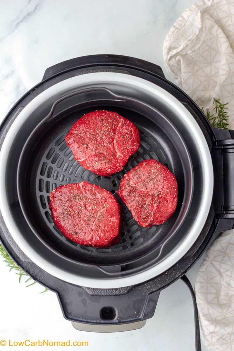 raw steaks in an air fryer