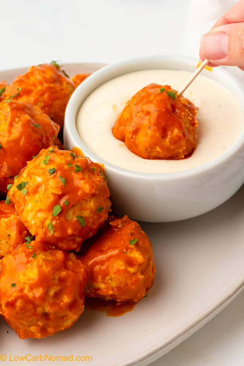 Buffalo Chicken Meatball being dipped in ranch dressing
