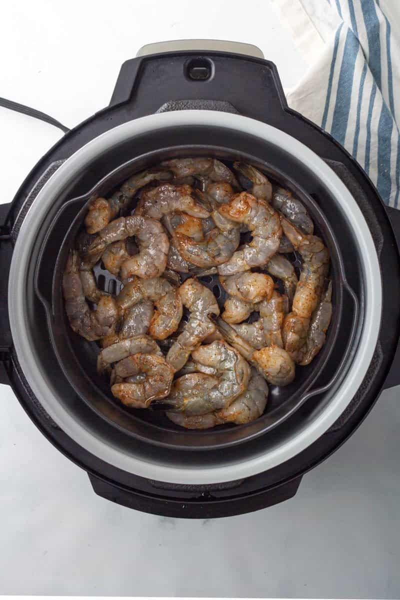 raw shrimp in air fryer basket