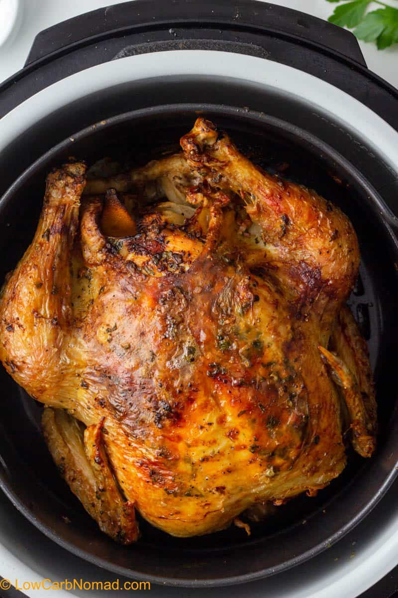 Air Fryer Whole Chicken in the air fryer close up photo