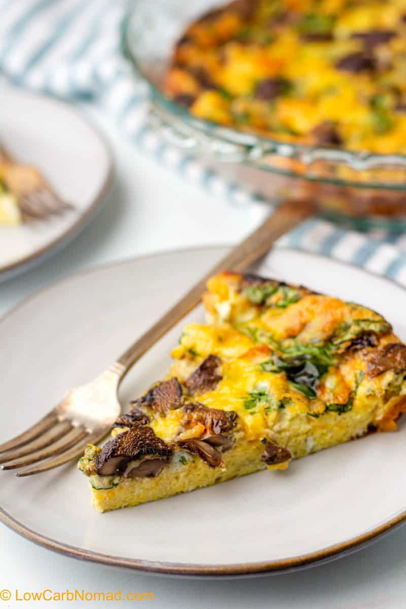 spinach and mushroom quiche on a plate