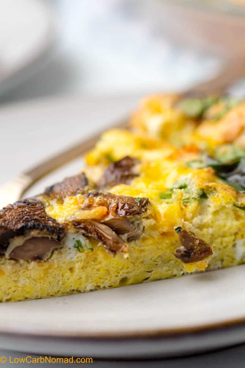close up photo of spinach and mushroom low carb crustless quiche