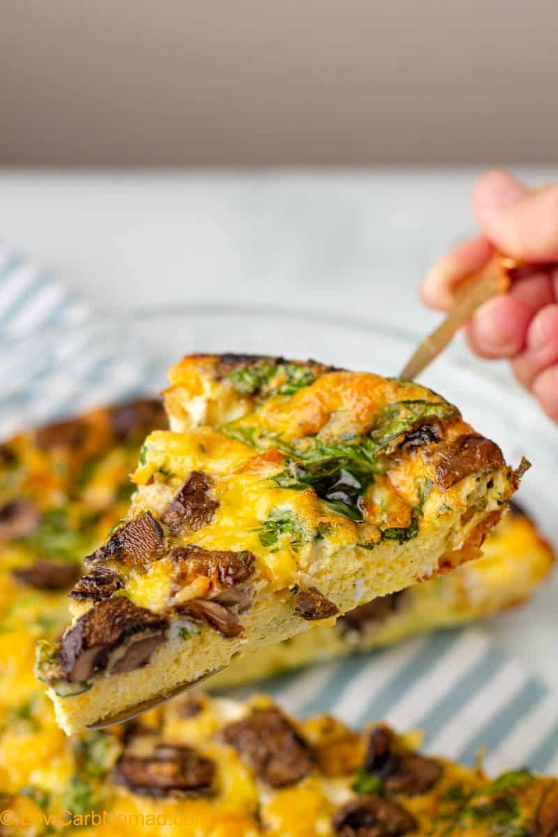 close up photo of spinach and mushroom quiche on a serving dish