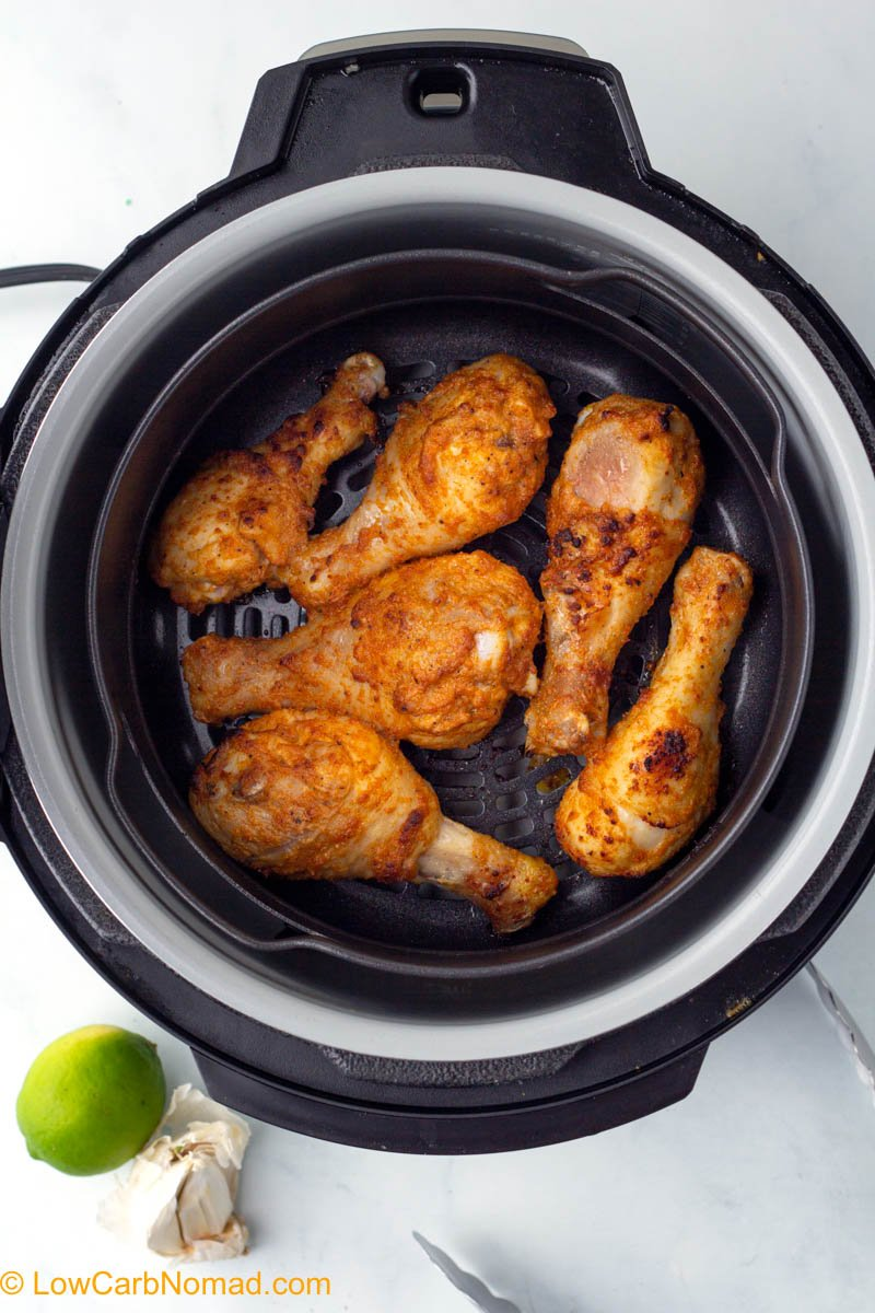 Air fryer chicken drumsticks in the air fryer cooking