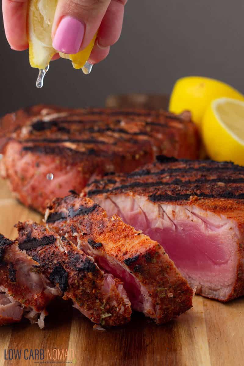 Sliced grilled tuna steaks close up photo