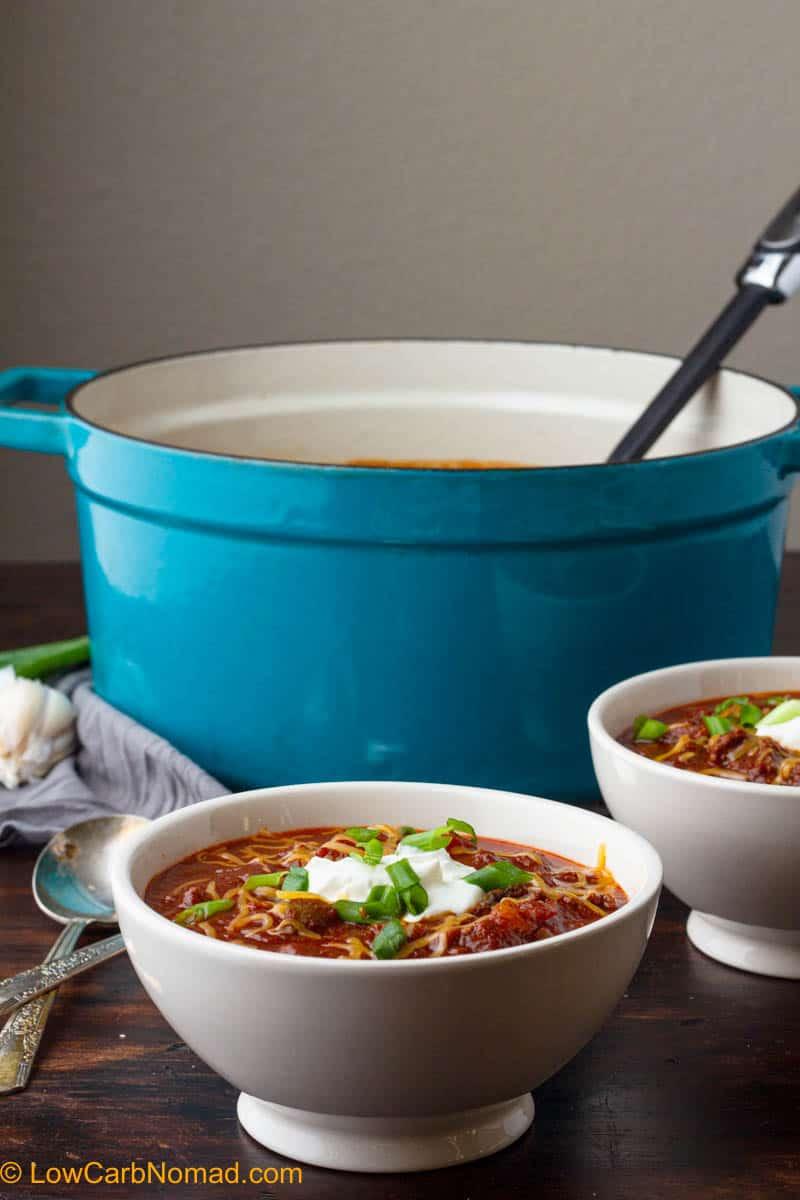 bowl of keto chili next to the full pot of no bean chili