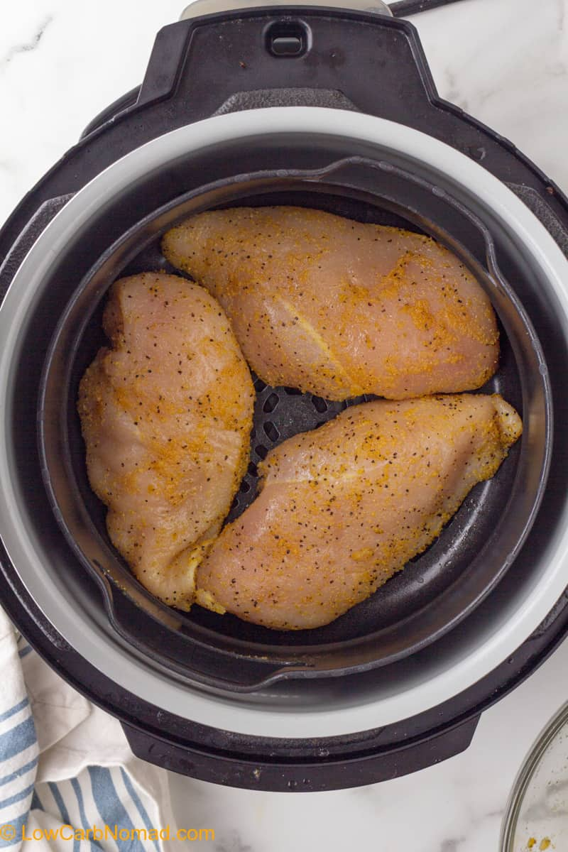 Air Fryer Chicken breasts uncooked in the air fryer