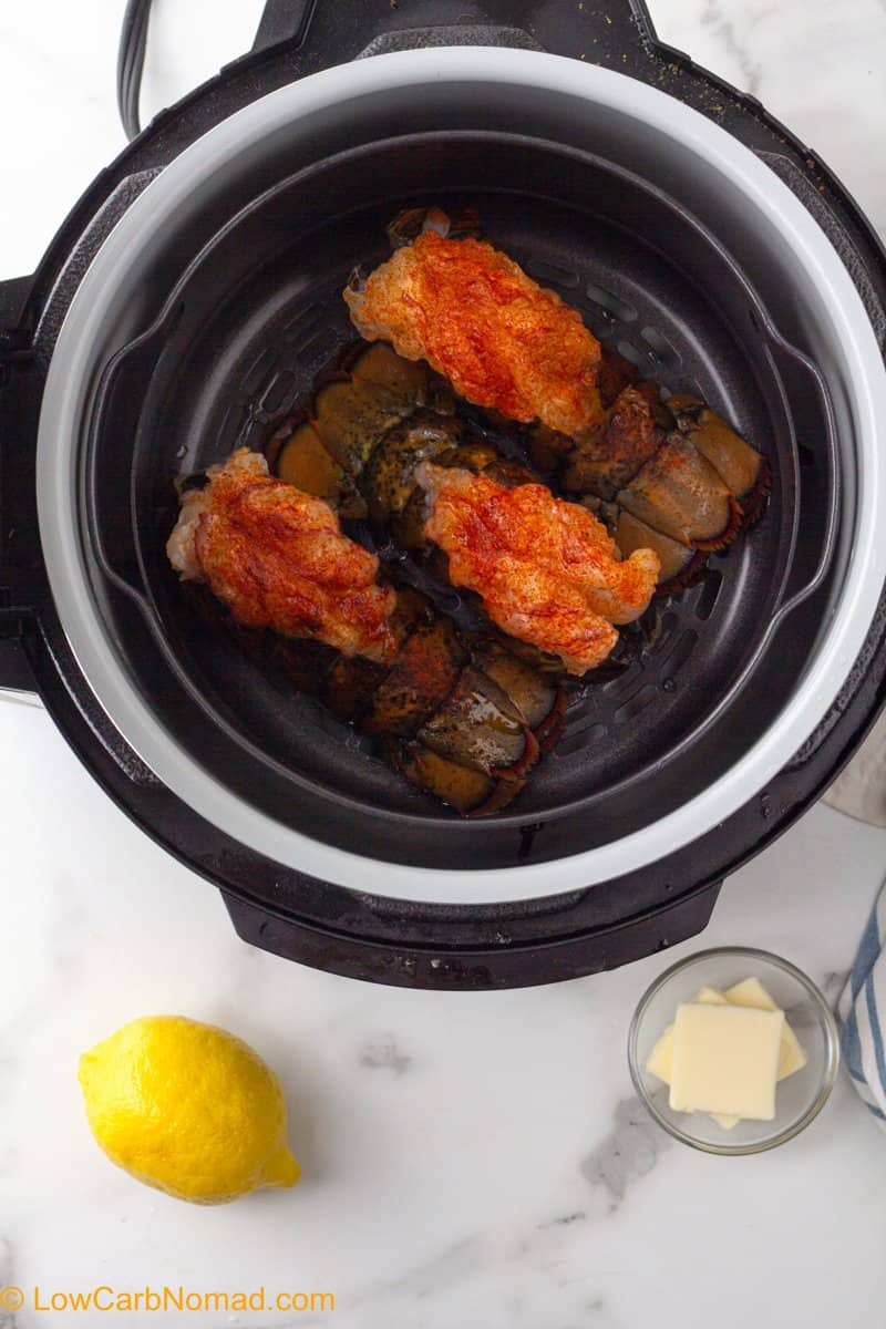 uncooked lobster tails in air fryer basket