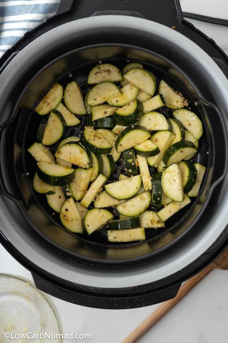 uncooked zucchini in air fryer baskett